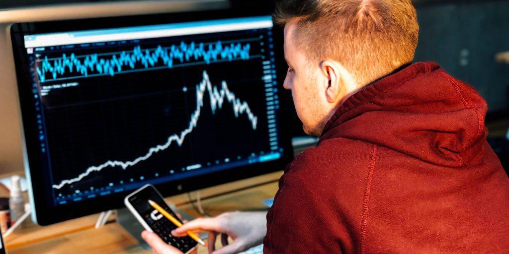 Day trader reading market charts